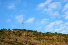 Telecommunications. Image of a telecommunications tower high on a cliff in Germany stock image
