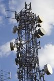 Telecommunications mast. Intricate structure bristling with cell phone and other communication dishes and aerials Stock Photography