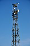 Telecommunications mast with blue sky Stock Image