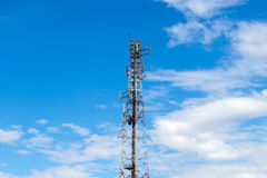 Telecommunications mast cloud sky. Old white red high telecommunications mast stands on cloudy skies are common royalty free stock photos