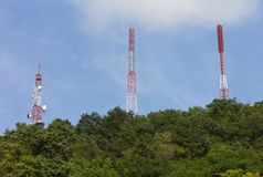 Telecommunications mast on many forests. Royalty Free Stock Images