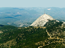 Telecommunications , mountaintop. Telecommunications tower on mountaintop, aerial view royalty free stock photos