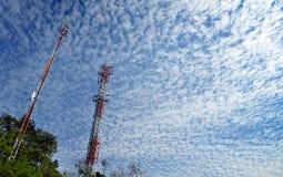 Telecommunications Pole. On beautiful Cloud Pattern background Royalty Free Stock Photography