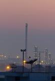 Telecommunications satellite dish and communications towers Stock Photo