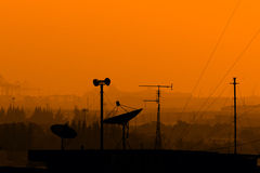 Telecommunications satellite dish and communications towers Royalty Free Stock Images