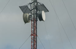 Telecommunications. A standard telecommunications tower with wires Stock Image
