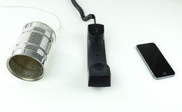 Telecommunications technology advancements showing tin can phone Stock Photos