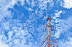 The telecommunications tower. With beautiful clouds Stock Photography