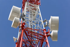 Telecommunications tower. On a blue sky background Royalty Free Stock Photos