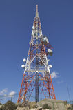 Telecommunications tower. In white and red Stock Photography
