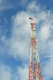 Telecommunications tower. Against blue sky Royalty Free Stock Photo