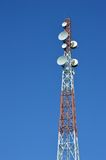 Telecommunications tower. Against blue sky Stock Photography