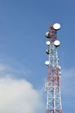 Telecommunications tower. Against blue sky Royalty Free Stock Image