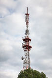 Telecommunications tower against cloudy sky Royalty Free Stock Images
