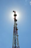 Telecommunications tower. Against the sunshine Stock Photo