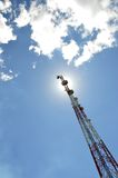 Telecommunications tower. Against the sunshine Royalty Free Stock Image