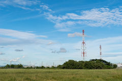Telecommunications tower with blue sky background Stock Image