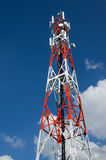 Telecommunications tower with blue sky and clouds. Telecommunications tower with blue sky Royalty Free Stock Photos