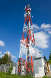Telecommunications tower with blue sky and clouds Royalty Free Stock Images