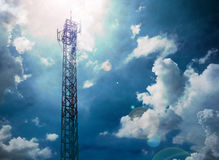 Telecommunications tower with blue sky and clouds sky,Raincloud. Stock Photos