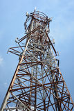 Telecommunications tower and blue sky, Thailand. Stock Photos