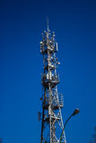 Telecommunications tower in the city. Background Stock Photos