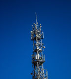 Telecommunications tower in the city. Background Royalty Free Stock Image