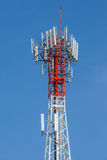 Telecommunications tower with clear blue sky background. Stock Photo