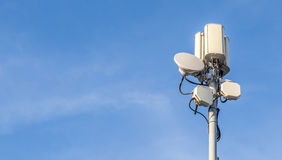 Telecommunications tower with clear blue sky background. Royalty Free Stock Image