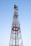 Telecommunications tower with clear blue sky. Royalty Free Stock Images