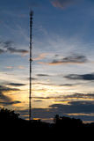 Telecommunications tower in the evening sky. Royalty Free Stock Image