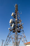 Telecommunications tower. Or metal tower with satellite dishes transmit and receive Royalty Free Stock Photography