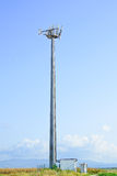 Telecommunications tower. Mobile phone station in a blue sky Royalty Free Stock Image
