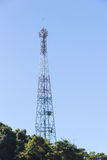 Telecommunications tower on the mountain. Multi purpose telecommunications tower over blue sky having antennas for tv, radio, cellular phones, microwave data Royalty Free Stock Photos