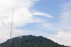 Telecommunications tower on the mountain blue sky background. Royalty Free Stock Images