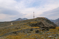 Telecommunications tower mountains top Stock Images