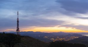 Telecommunications tower over the city of Donostia. At dusk from Mount Jaizkibel Stock Photography