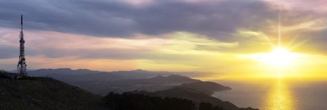 Telecommunications tower over the city of Donostia at dusk. From Mount Jaizkibel Stock Photography