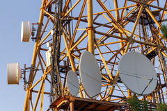 Telecommunications tower. Part of the TV tower with satellite and cellular antennas Royalty Free Stock Image