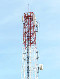 Telecommunications tower with satellite dish Stock Photos