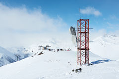 Telecommunications tower at a ski resort. On a high mountain Royalty Free Stock Image