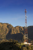 Telecommunications tower at sunrise and blue sky. Stock Image