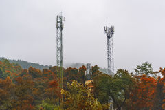 Telecommunications tower at sunrise and blue sky. Royalty Free Stock Image