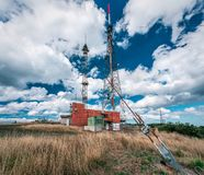 Telecommunications tower on top of the mountain stock photo