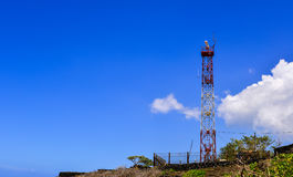 Telecommunications tower under a blue sky Royalty Free Stock Image