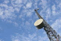 A telecommunications tower. View with blue sky Stock Photo