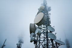 Telecommunications towers. Into the clouds Royalty Free Stock Images