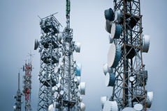 Telecommunications towers. Against a unreal sky Royalty Free Stock Photo