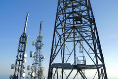 Telecommunications towers 4. Group of telecommunications towers at the sunset Stock Photos