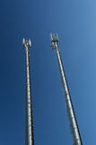 Telecommunications towers with blue sky Royalty Free Stock Photo